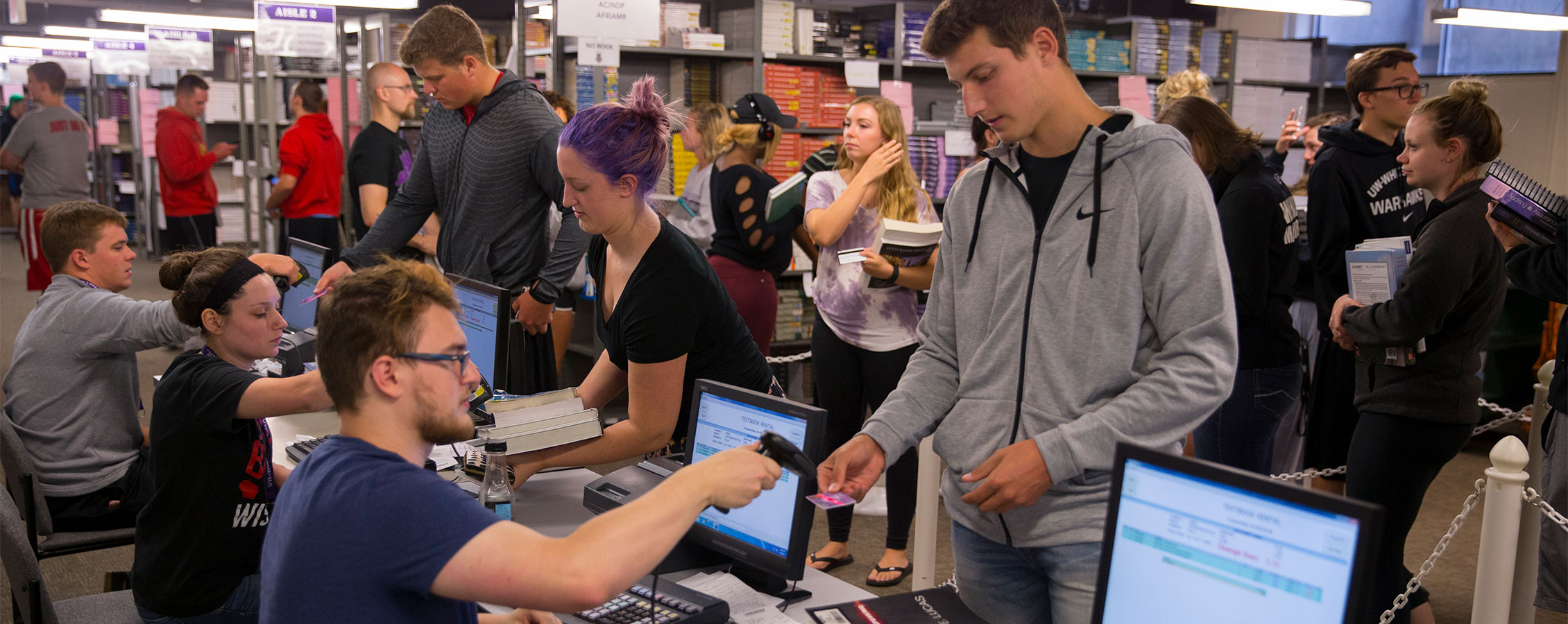 Students check out textbooks on the lower level of the UW-Whitewater bookstore.