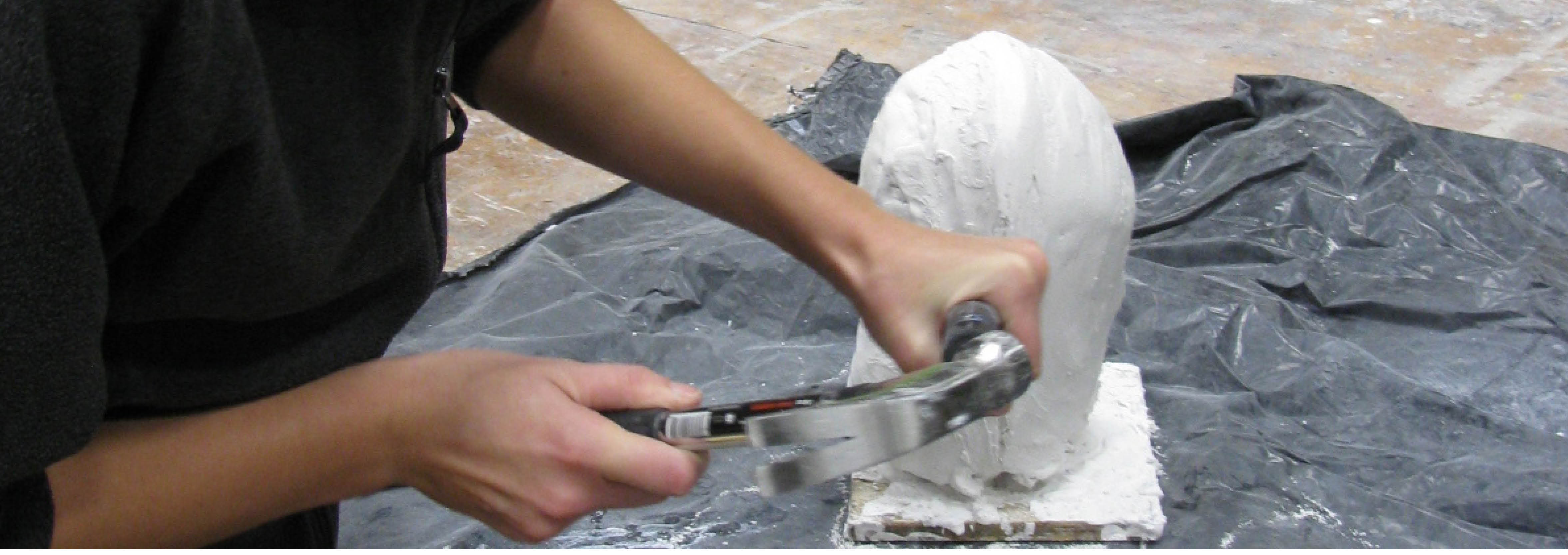 student works on a sculpture
