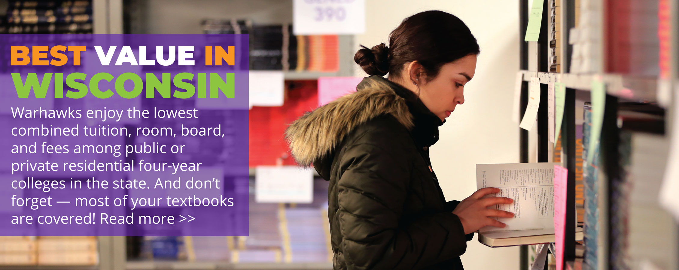 A student looks at books.