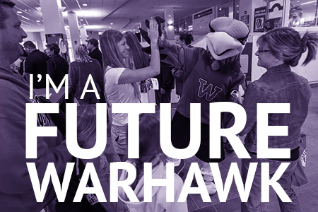 I'm a Future Warhawk: Student high-fives with campus mascot while parents look on