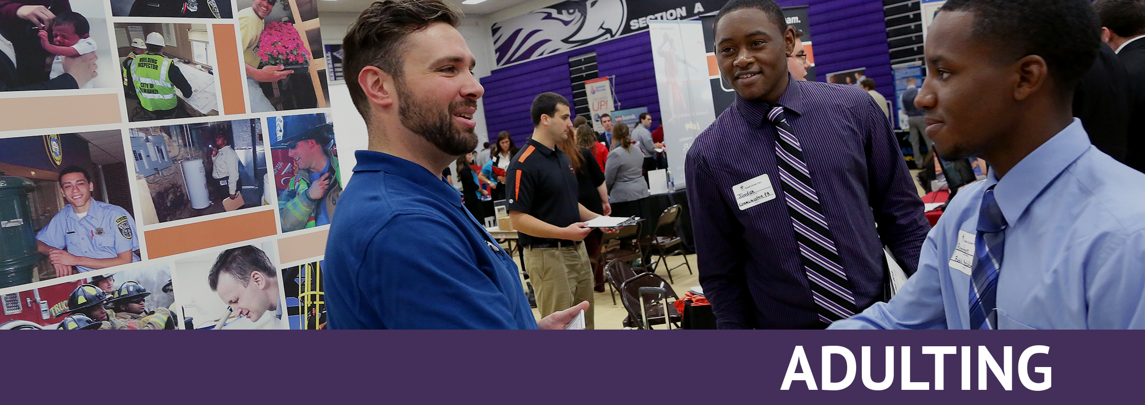 Adulting: Two students in ties shake hands with a recruiter at a job fair